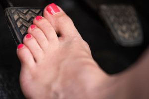 Girl driving barefooted