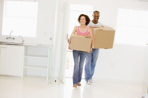 3485780 - couple with boxes moving into new home smiling