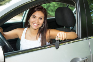 44950997 - teen holding up keys to her new car