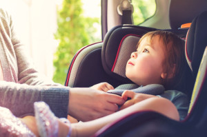 73897173 - toddler girl buckled into her car seat